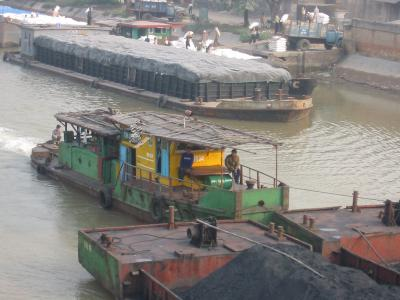 Photo of barges and boats in port at Haiphong
