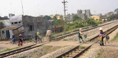 Photo of bicyclists crossing railroad tracks