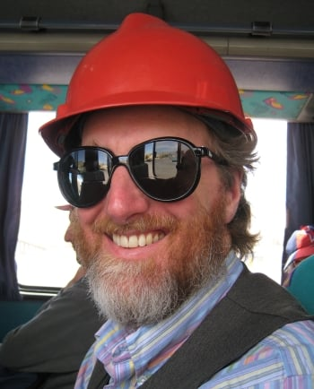 Edward Hasbrouck on tour bus in hard hat