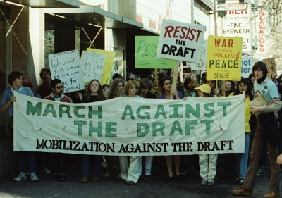 Women marching with banner: Lesbian Anti-Draft Action