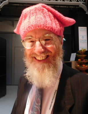 Edward Hasbrouck wearing a pink pussy hat