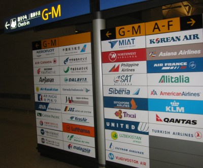signs for check-in counters at ICN airport